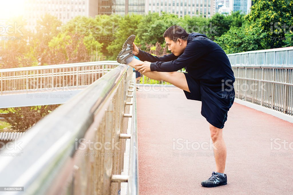 Man stretching before running stock photo