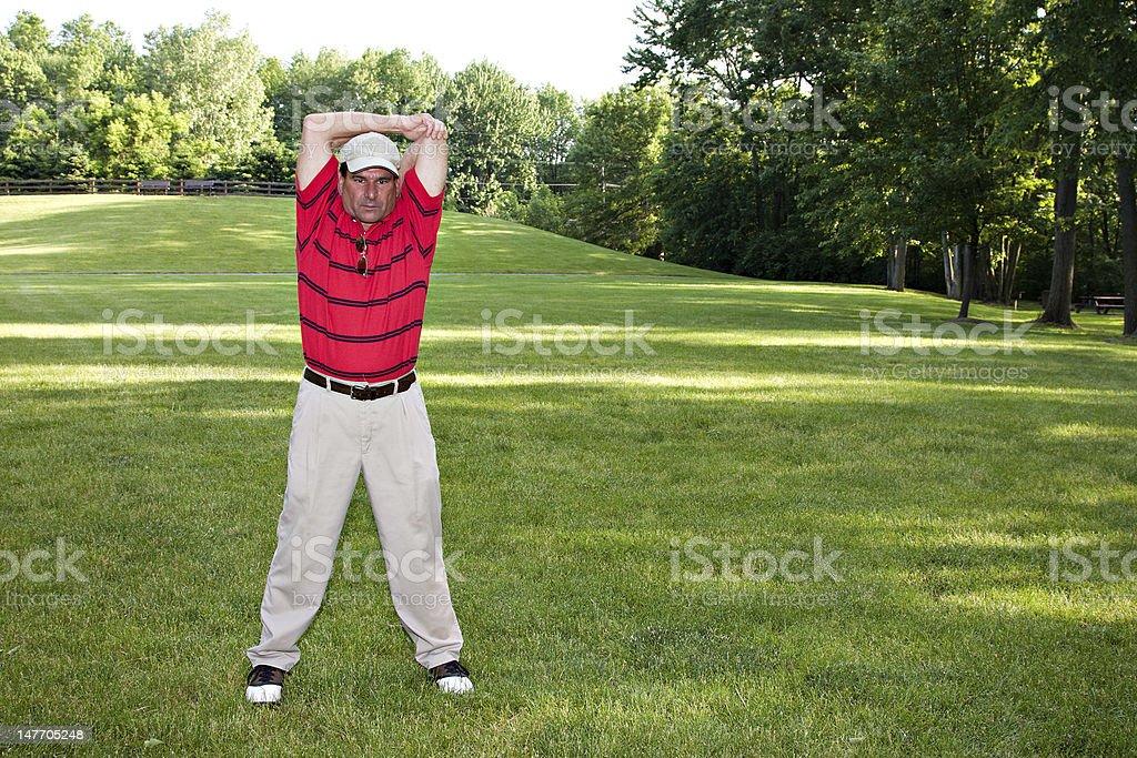 Man Stretching Golf royalty-free stock photo