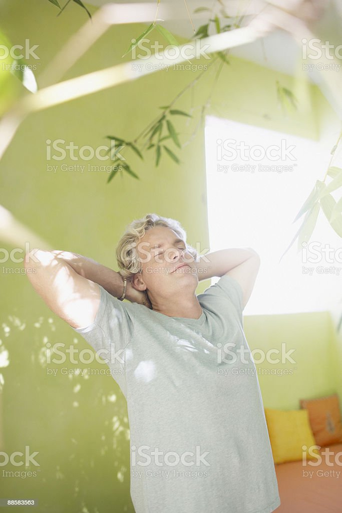 Man stretching on patio royalty-free stock photo