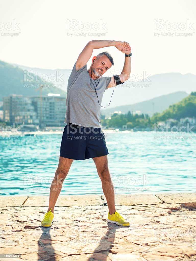 Man stretching stock photo