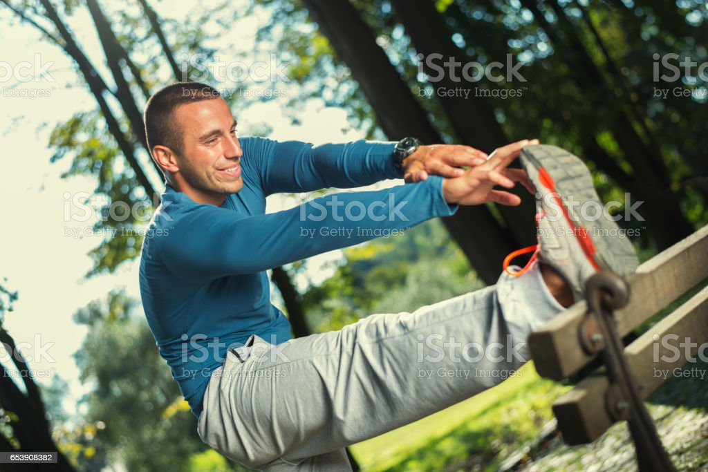 Man stretching stock photo