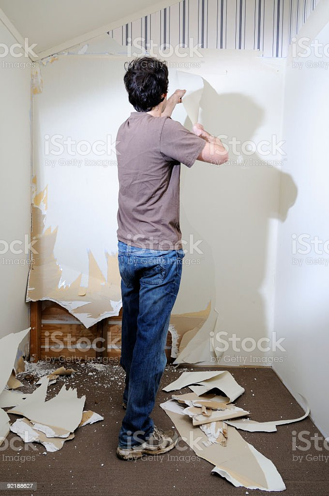 man stripping out room royalty-free stock photo