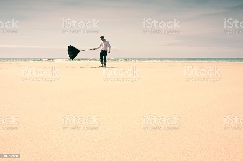 Man Struggling with Umbrella stock photo