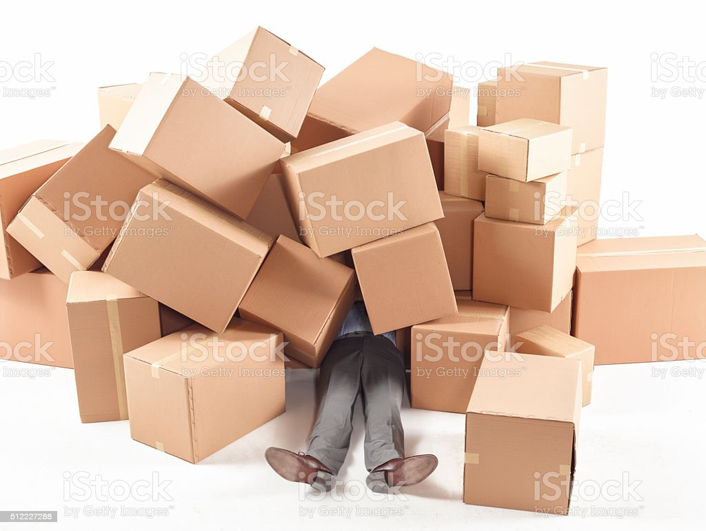 Man stuck under the with boxes stock photo