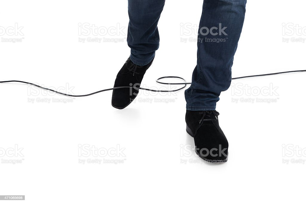 Man Stucked In Cable While Walking stock photo