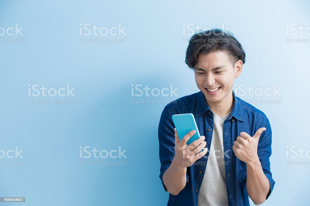 man student use phone stock photo