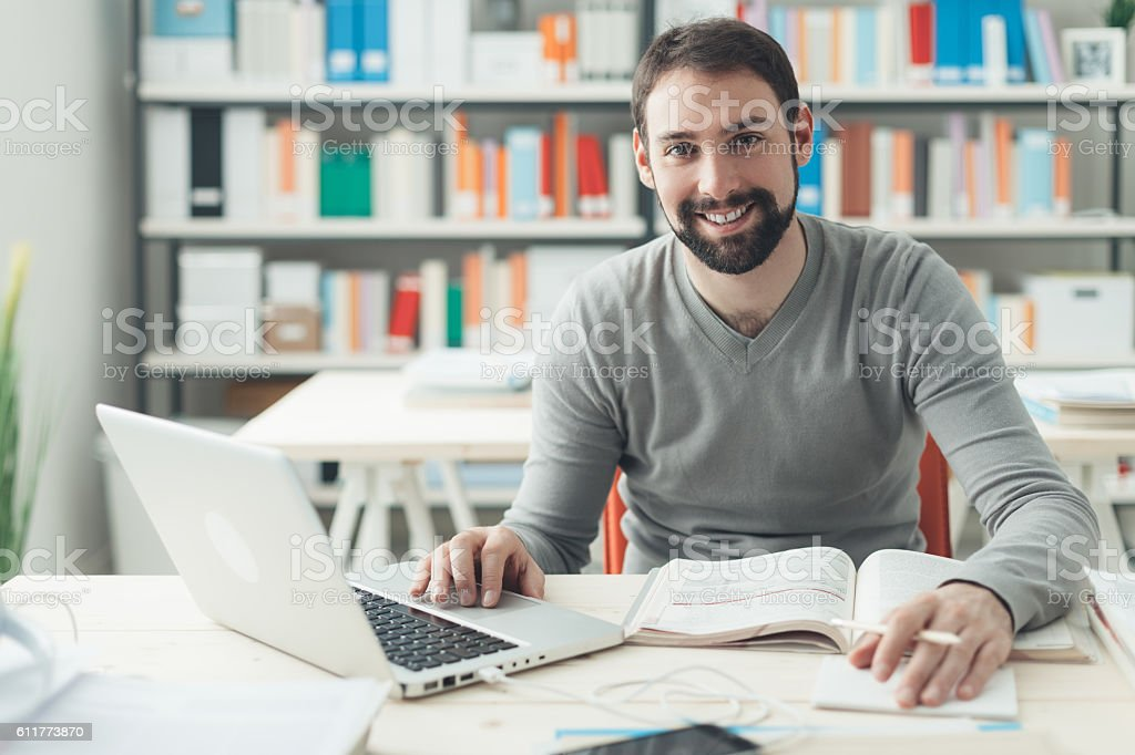 Man studying in the office stock photo