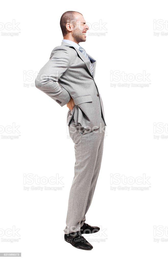 Man suffering for a backache full length stock photo