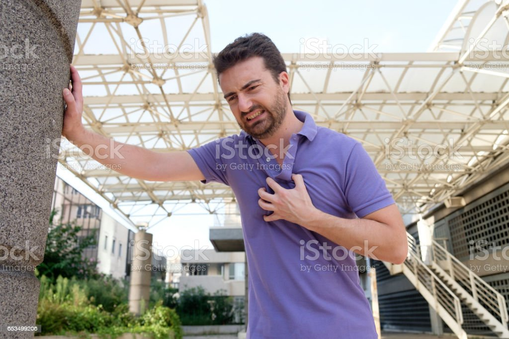 Man suffering for a bad heart attack stock photo