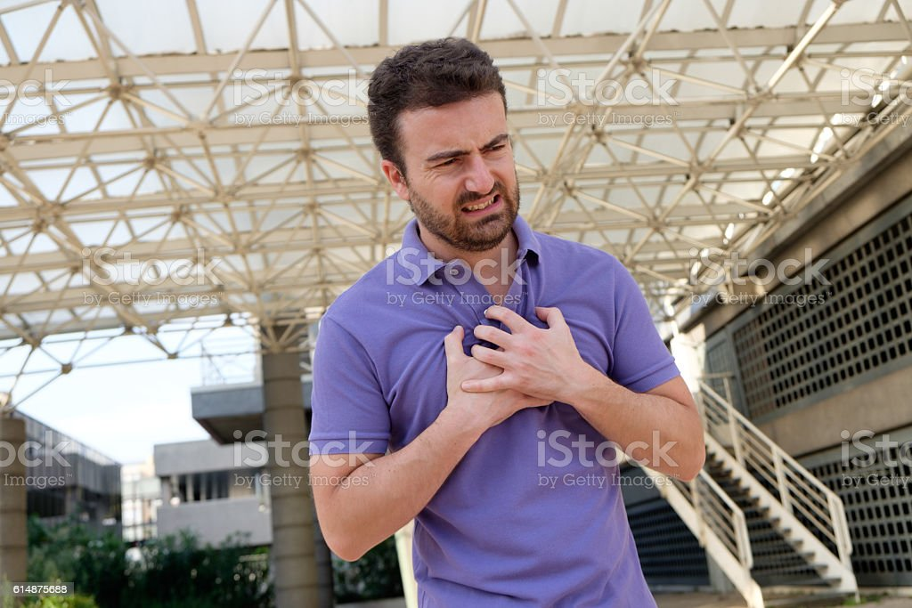 Man suffering for a sudden heart attack stock photo