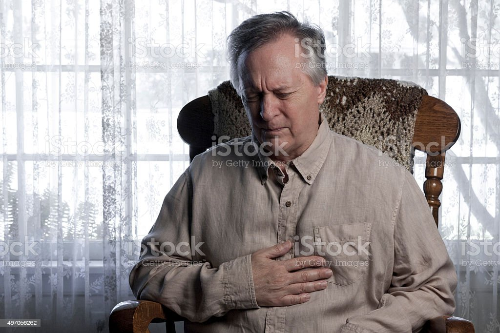 Man Suffering from Chest Pains stock photo