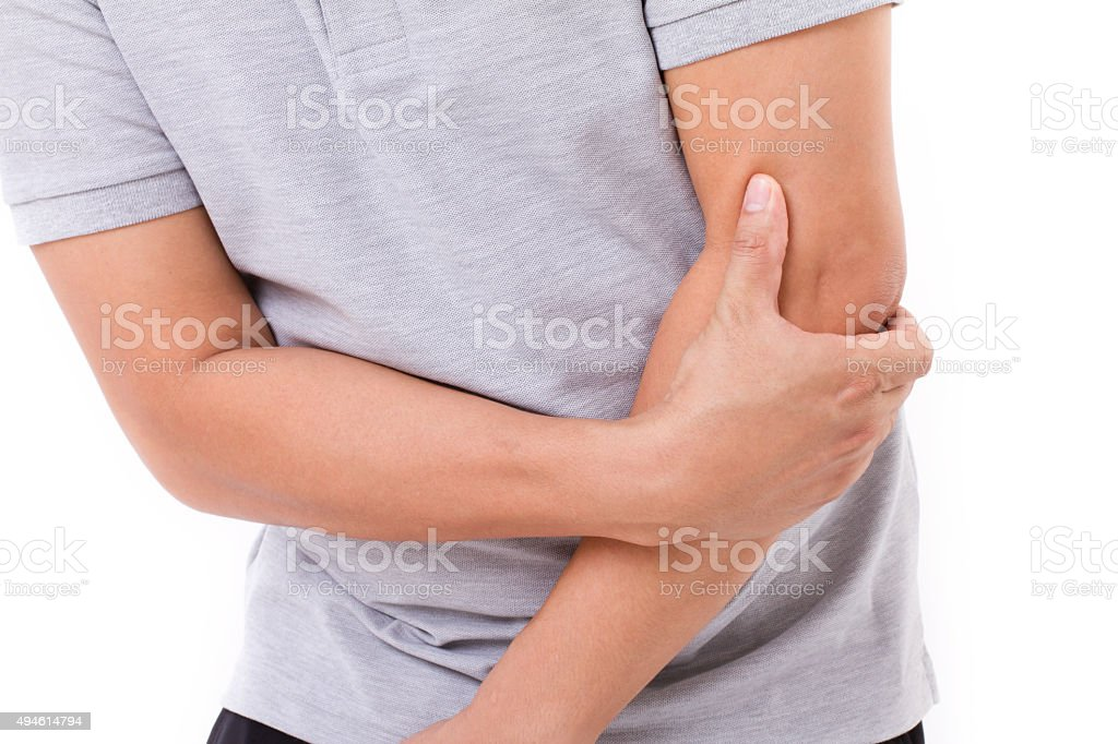 man suffering from elbow joint pain stock photo