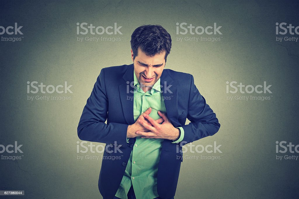 Man suffering from heartache chest pain. Heart disease stock photo