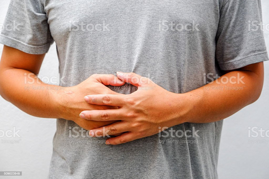Man Suffering From Stomach Ache stock photo