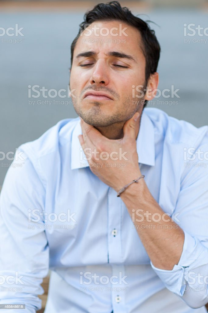man suffering from throat problems stock photo