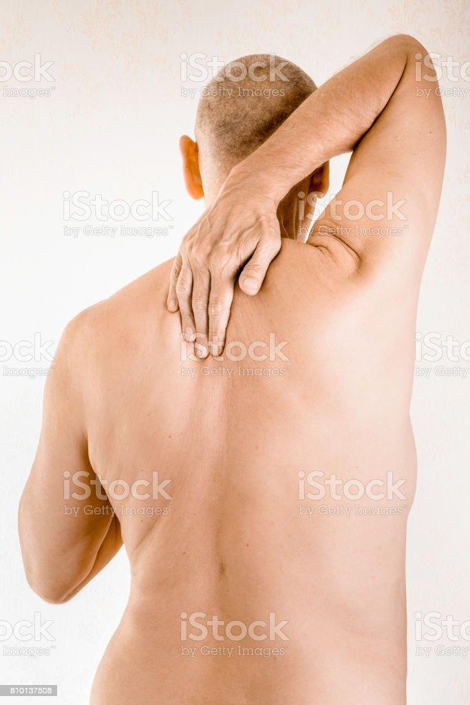 Man suffering of thoracic vertebrae pain stock photo