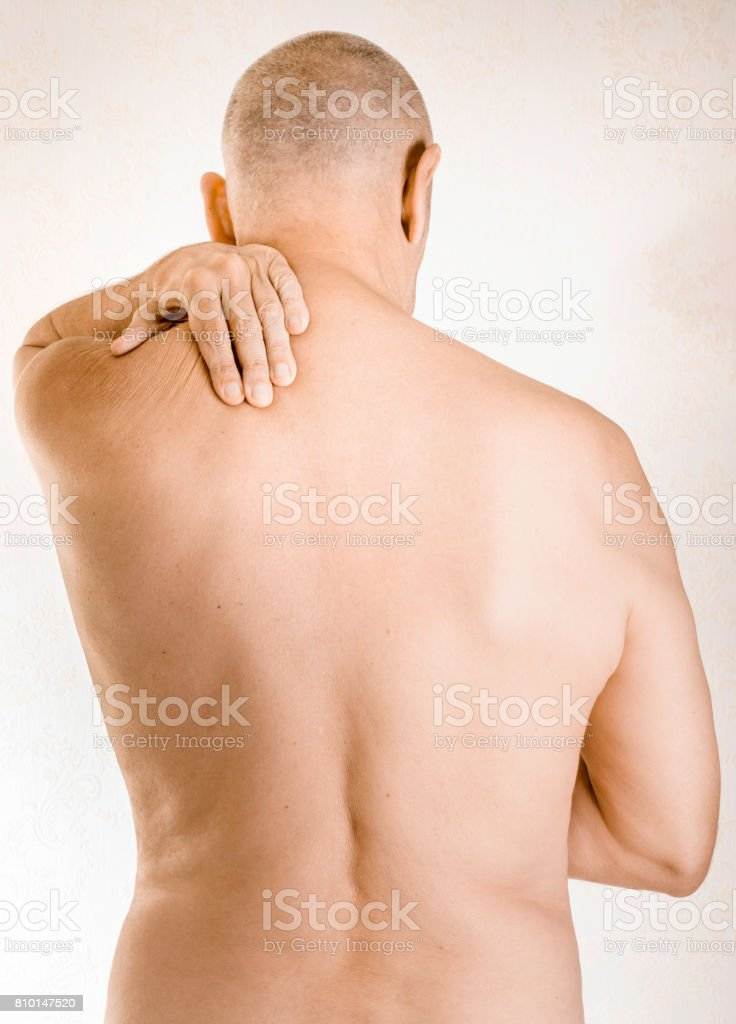 Man suffering of trapezius muscle pain stock photo