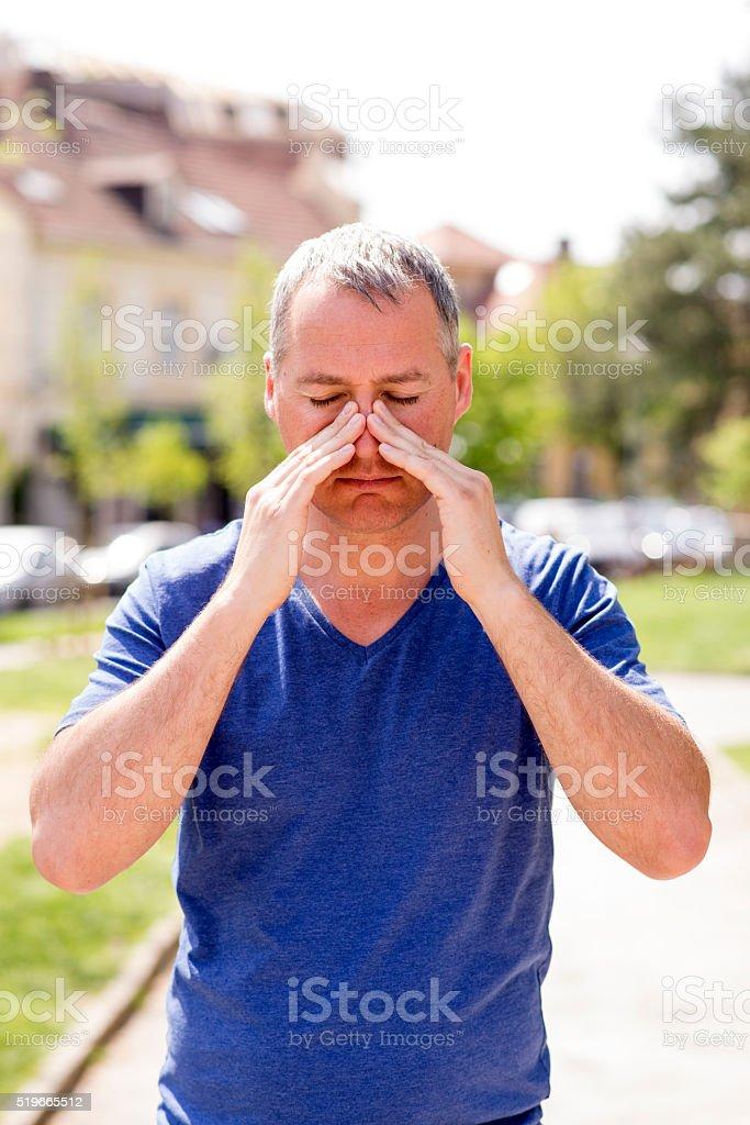 man suffering sinusitis stock photo