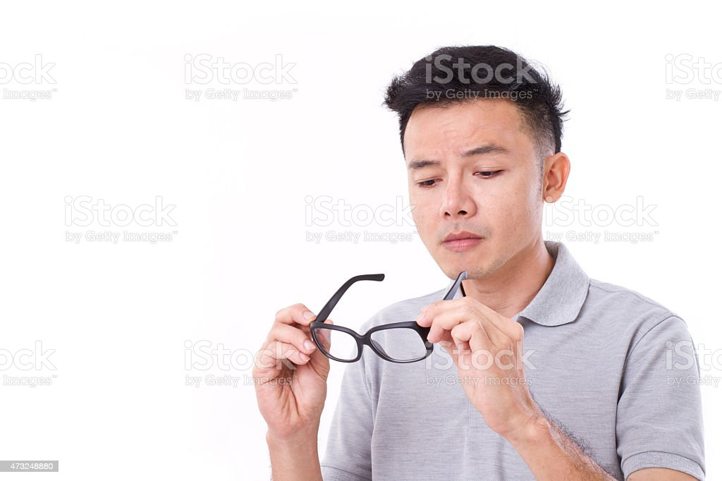 man suffers from short-sightedness, myopia or others eye disorde stock photo