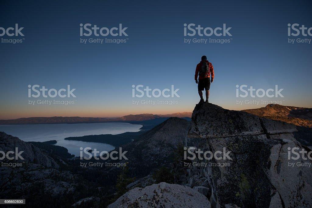 Man summiting a beautiful mountain top in Lake Tahoe stock photo