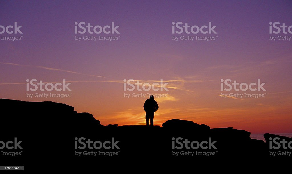Man sunset silhouette Godrevy Cornwall royalty-free stock photo