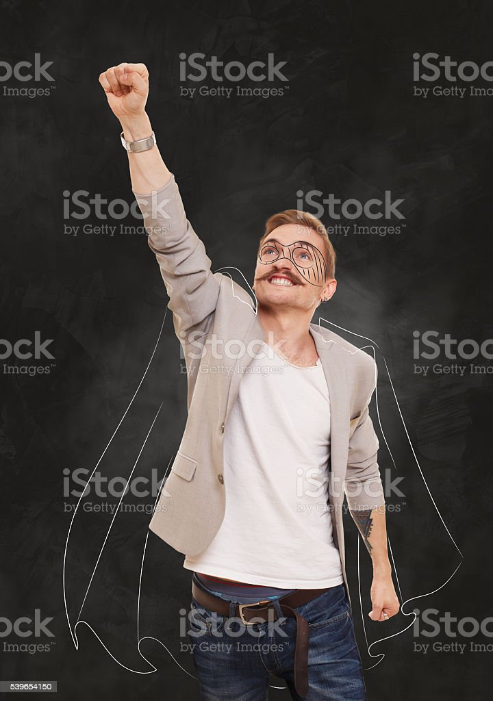 Man Superhero in flying pose at black background stock photo