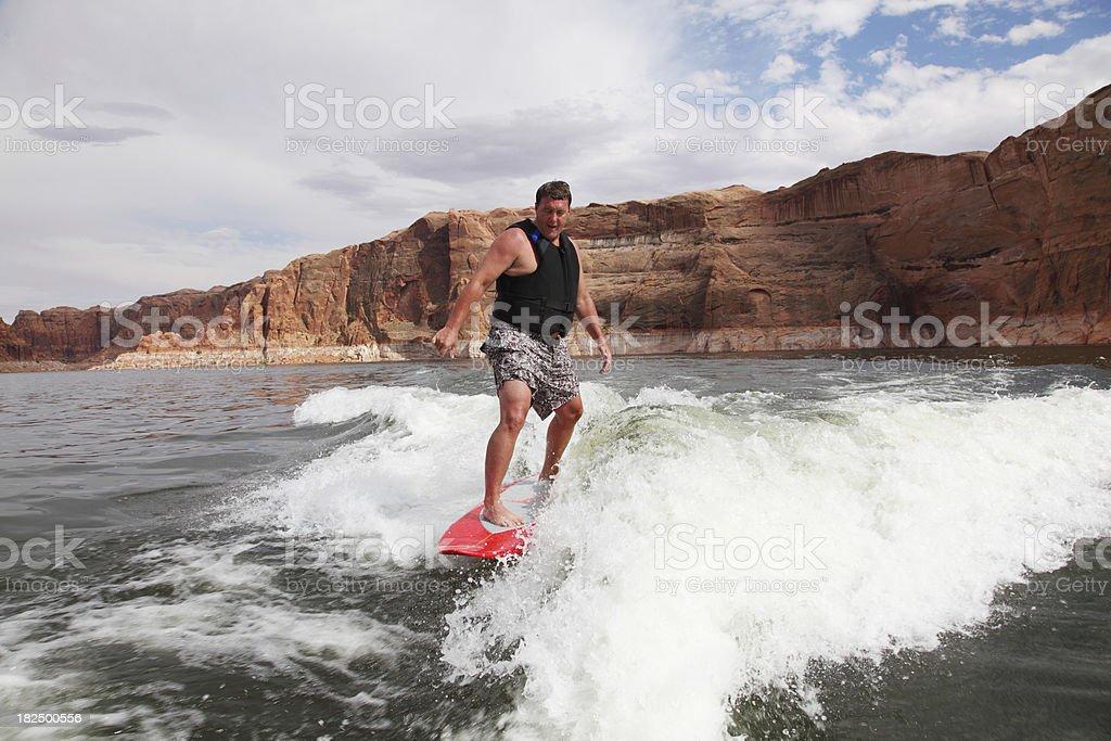Man Surfing At Lake Powell stock photo