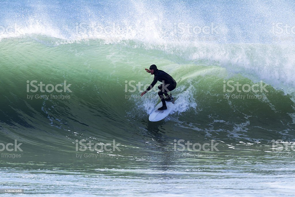 A man surfing through a water barrel stock photo