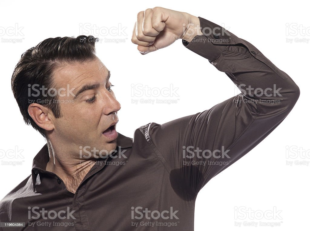 Man surprised Portrait looking at sweat stain perspiring stock photo