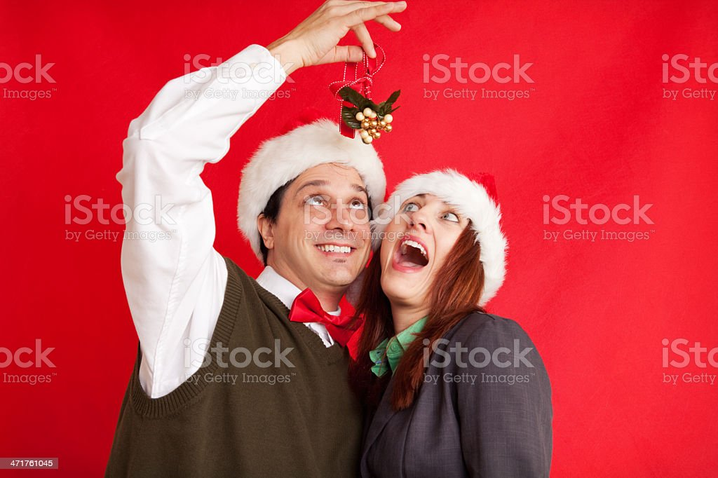 Man Surprises Woman With Mistletoe royalty-free stock photo