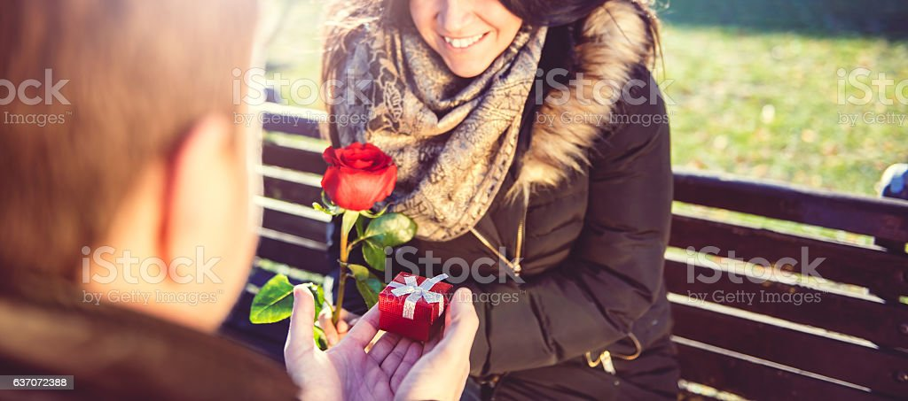 Man Surprises woman With small Gift stock photo