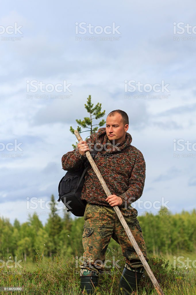 man survives in a swamp stock photo