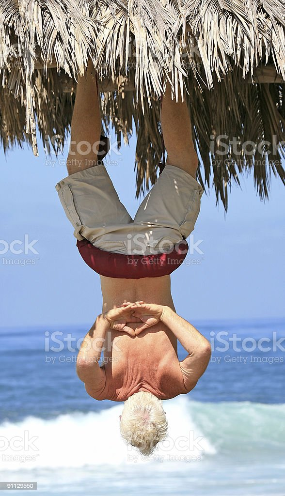 Man suspended upside down royalty-free stock photo