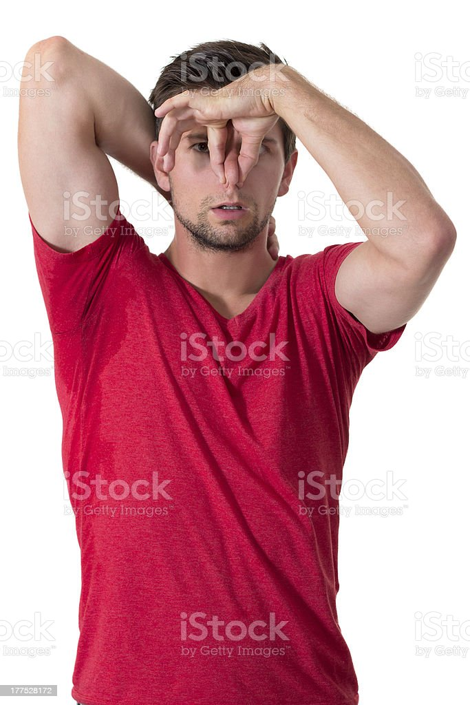 Man sweating very badly under armpit and holding nose royalty-free stock photo
