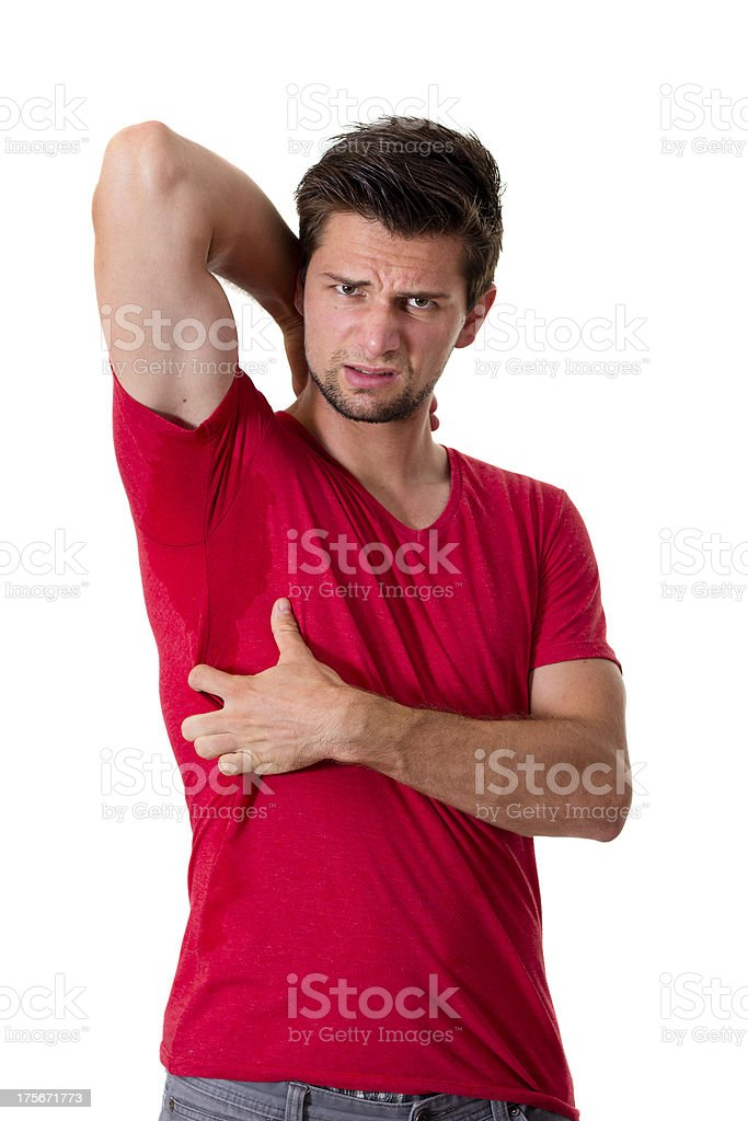 Man sweating very badly under armpit and pointing there royalty-free stock photo