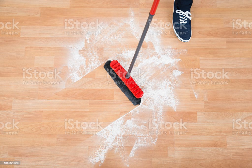 Man Sweeping Hardwood Floor stock photo