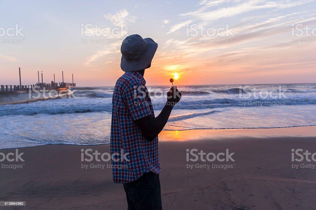 Man Sweet Beach Sunrise Silhouetted stock photo