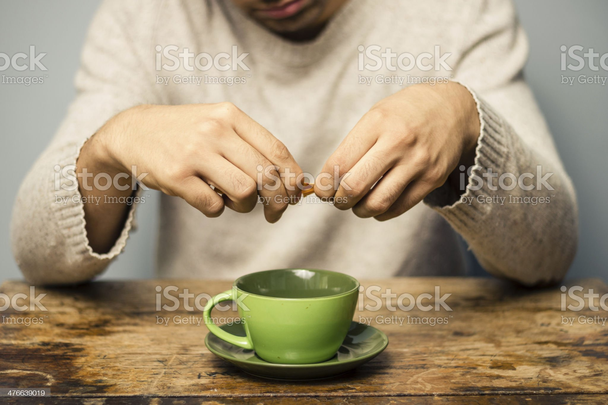 Man sweetening his drink royalty-free stock photo