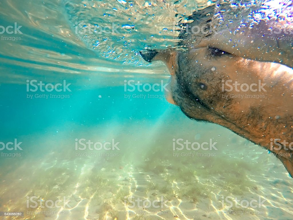 Man swimming in the ocean. stock photo