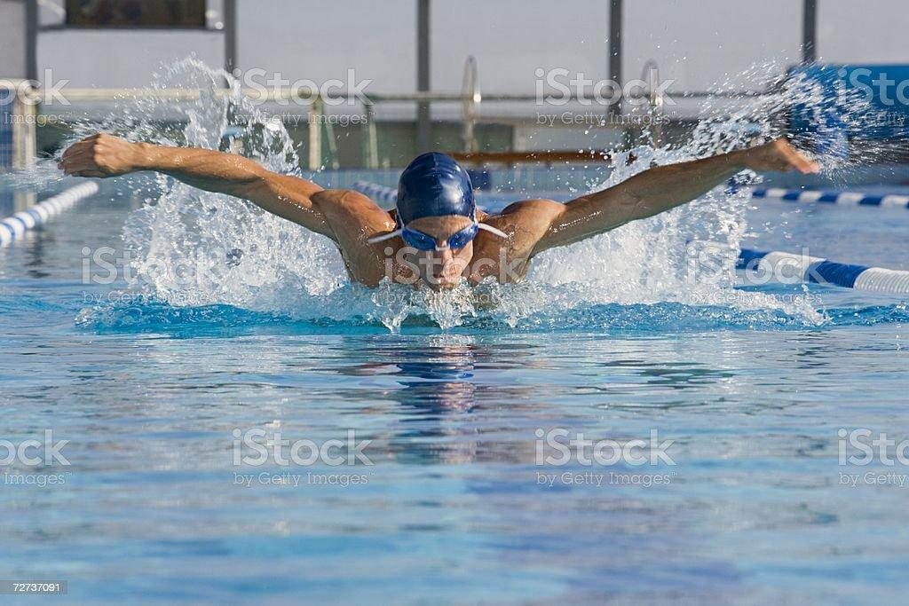 Man swimming stock photo