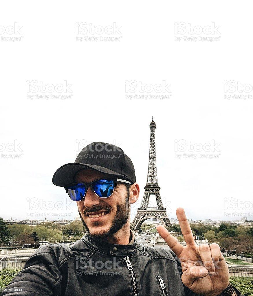 man take a selfie in paris with the tour eiffel stock photo