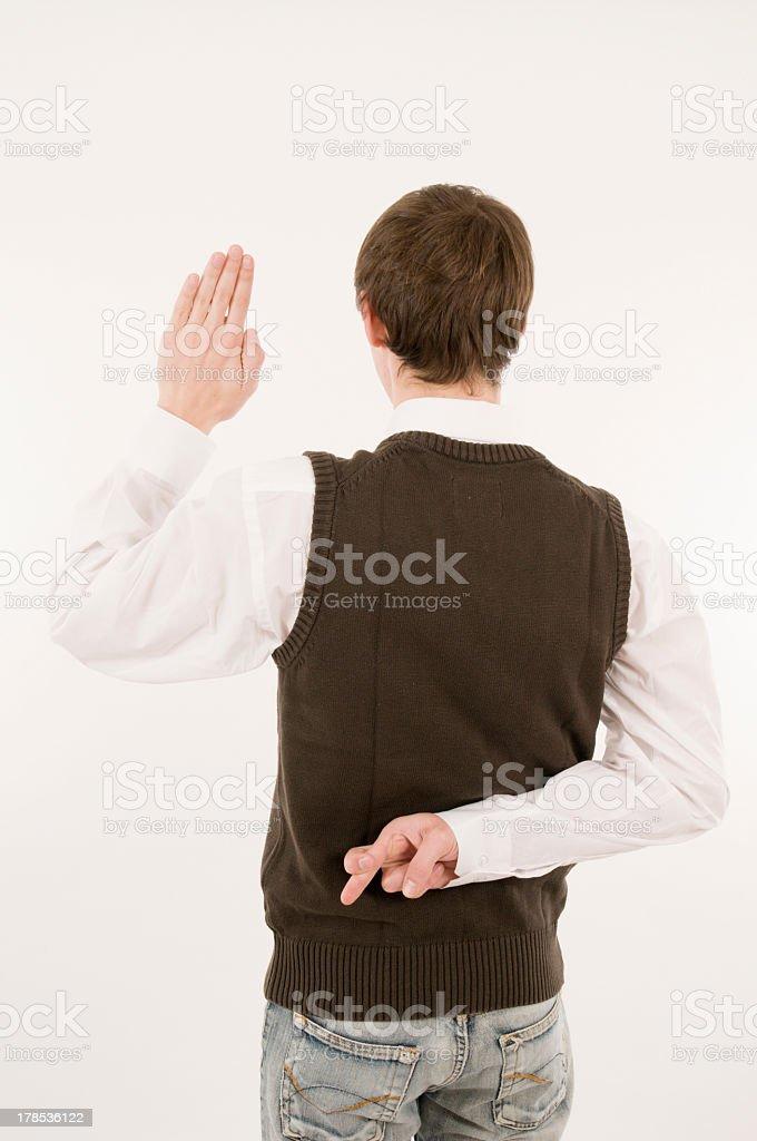 man take an oath cross ones fingers back stock photo