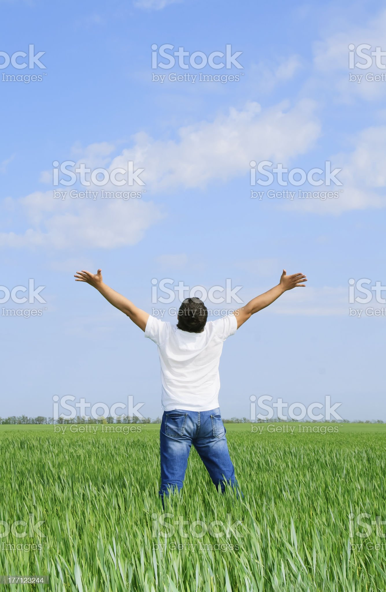 man take energy from nature in the meadow royalty-free stock photo