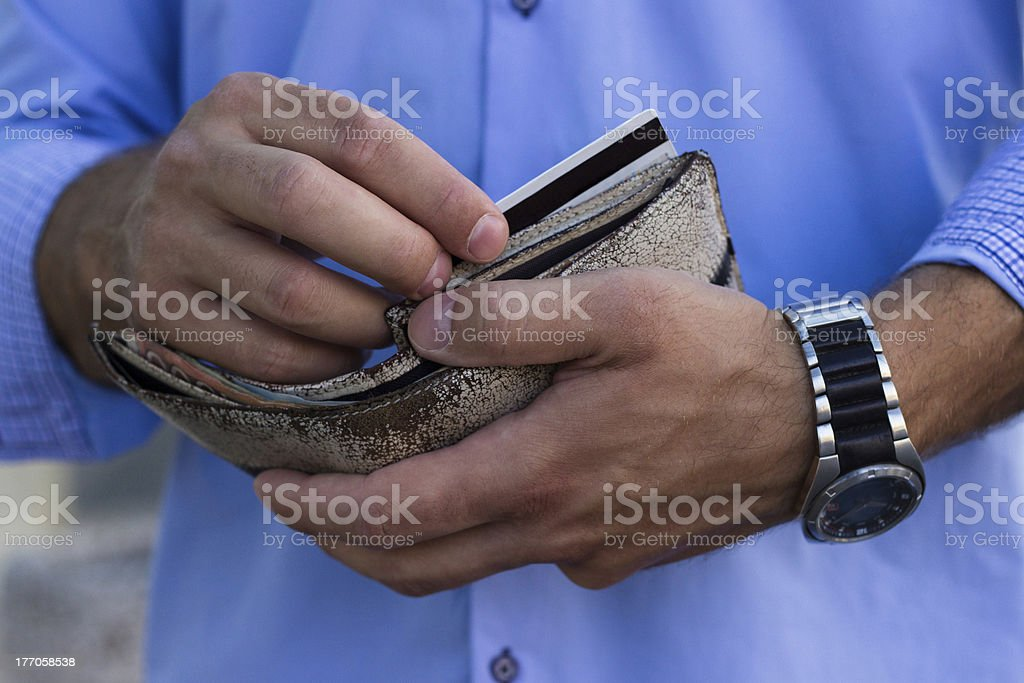 Man takes out a credit card from the wallet royalty-free stock photo