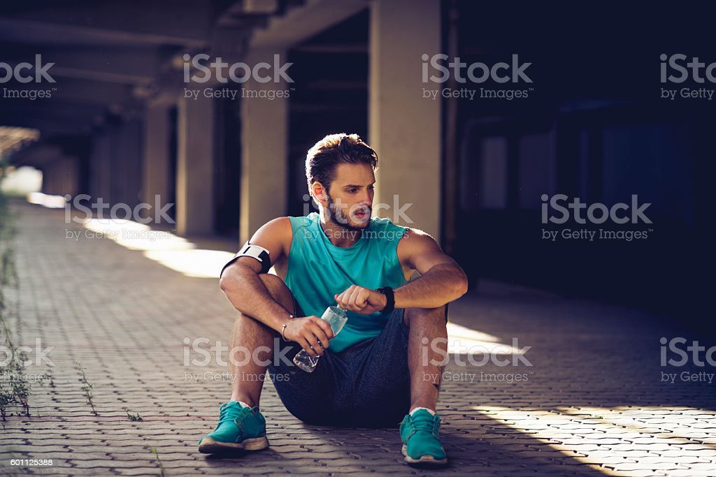 man taking a break after workout stock photo