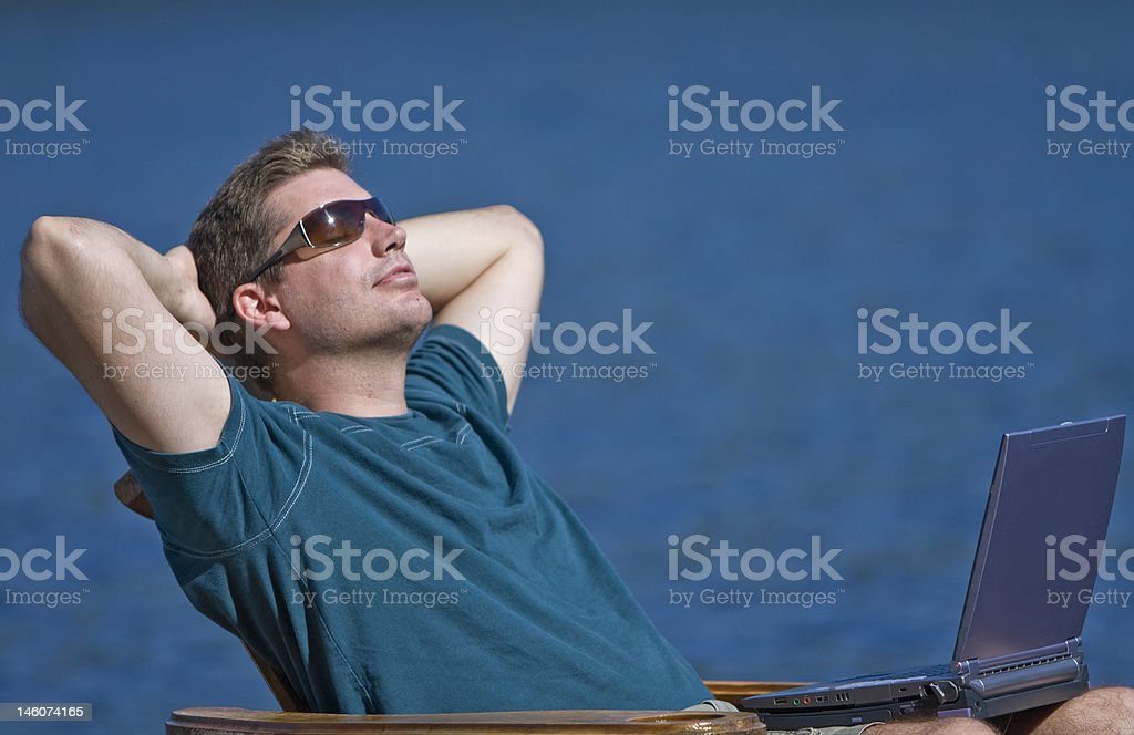 Man taking a break from working on his laptop royalty-free stock photo