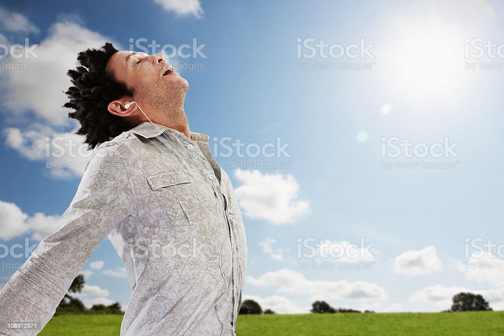 man taking a deep breathe outdoors royalty-free stock photo