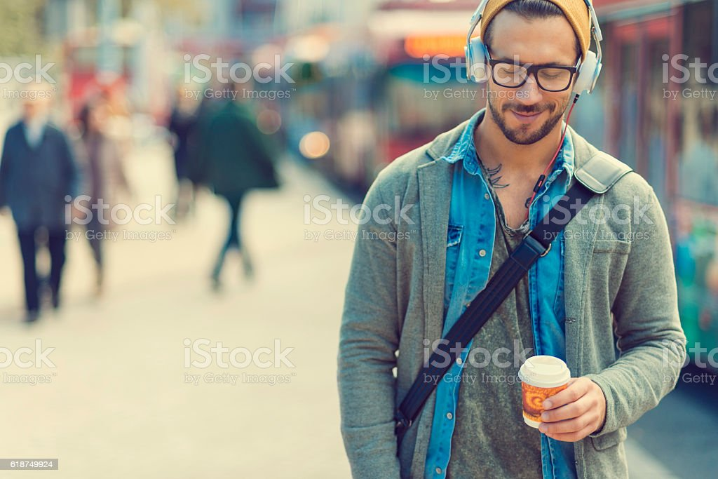 man taking a moment and enjoying the music stock photo