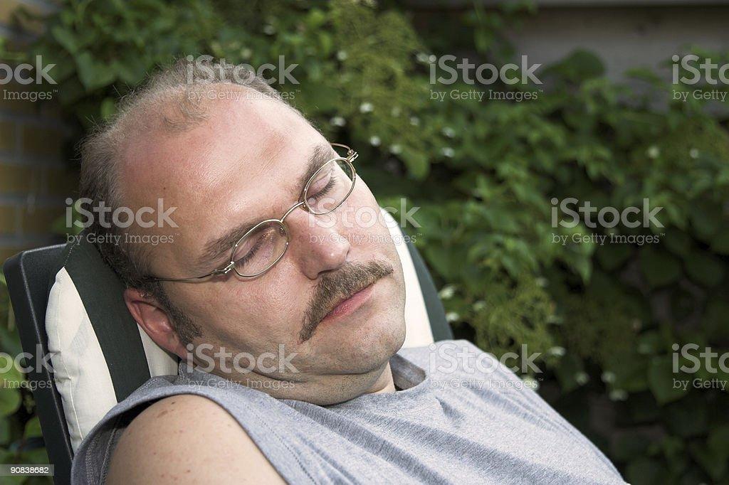 Man taking a nap royalty-free stock photo