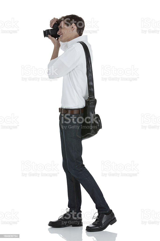 Man taking a picture with camera stock photo